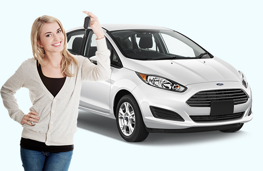 Photo of a young woman holding up a set of keys in front of a Ford Fiesta